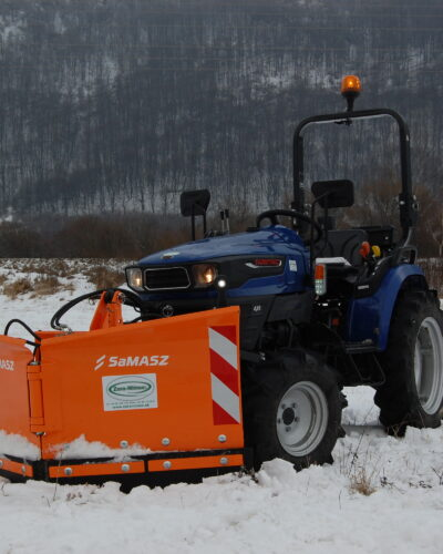 Compact tractor with a plow
